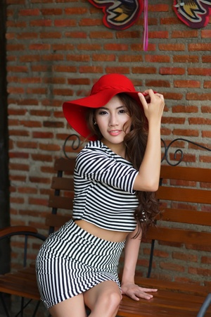 Beautiful young woman posing alone at the outdoor cafe, Model is Thai Ethnicity. photo