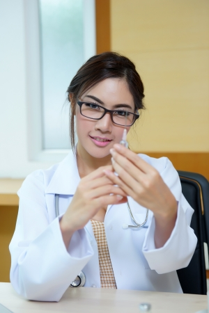 Medical doctor woman holding syringe. photo