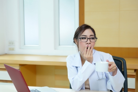 Female doctor had a very exhausting day at work  photo