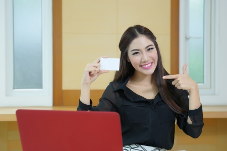Young woman shopping on the Internet with credit card.  photo