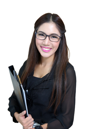 Portrait of confident young businesswoman with file folder in office photo
