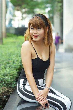 Young Asian woman posing in urban scene. photo