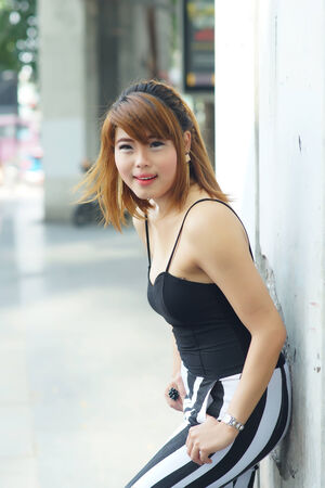 Young Asian woman posing in urban scene. photo