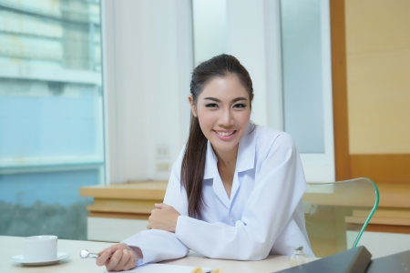 Young beautiful woman dentist holding dental tools. photo