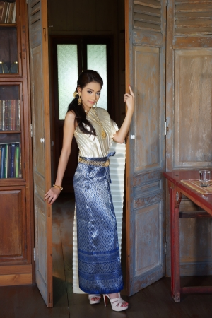 Thai woman wearing typical Thai dress, identity culture of Thailand photo