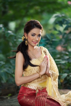 typical: Thai woman wearing typical Thai dress, identity culture of Thailand  Stock Photo