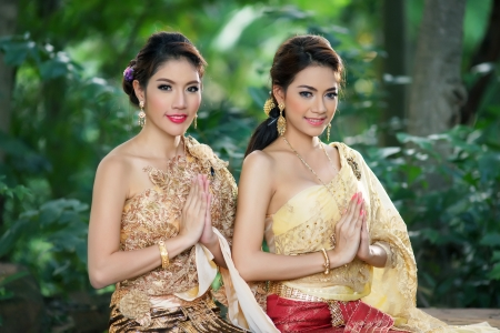Two Thai woman wearing typical Thai dress, identity culture of Thailand Banco de Imagens - 24533277