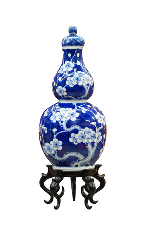 Chinese antique blue and white vase, Museum quality on wooden stand, isolate on white background Stock Photo