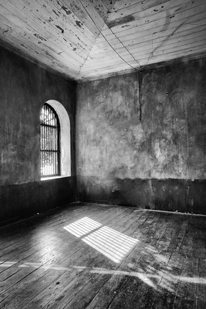 Light coming through abandoned houses window (black and white) photo