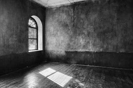 Light coming through abandoned house's window (black and white)