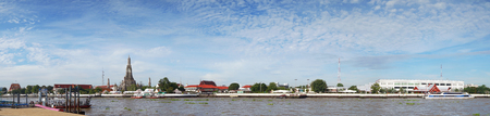 Wat Arun Temple of Dawn in Panoramic View Bangkok Thailand, with beautiful blue sky and clouds on background. Stock Photo
