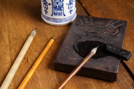 inkstone: Close up of Chinese Writing Brush, focus on the brush.