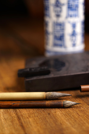 inkstone: Close up of Chinese Brush, focus on the brush. Selective focus with shallow depth of field.
