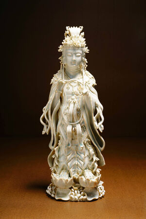 quan yin: Ancient Quan Yin - Buddhist Goddess of mercy -  ceramic statue Stock Photo