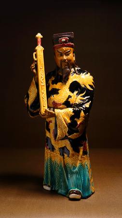 ceremic: Ancient ceramic statue - Bao QingTian god of justice. Stock Photo