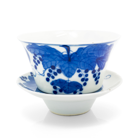 Chinese antique blue and white tea bowl, cover and saucer, on white background photo