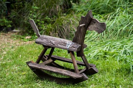 rocking: Wooden rocking toy on yard garden.