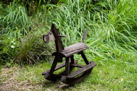 Wooden rocking toy on yard garden. photo