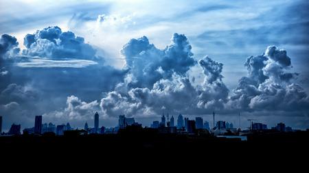 heavy rain: Dark blue storm clouds over city in rainy season. Stock Photo