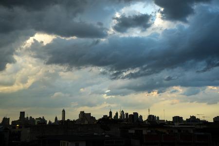 dark city: Dark blue storm clouds over city in rainy season. Stock Photo
