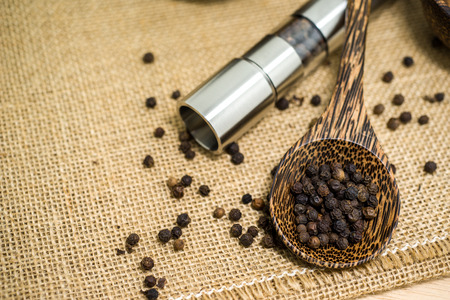 peppercorn: Pepper grinder and black peppercorn. Stock Photo