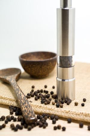 pepper grinder: Pepper grinder and black peppercorn. Stock Photo