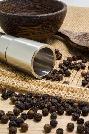 grinder: Pepper grinder and black peppercorn. Stock Photo