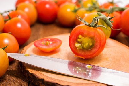 tomato slices: Red tomato slices on cutting board.