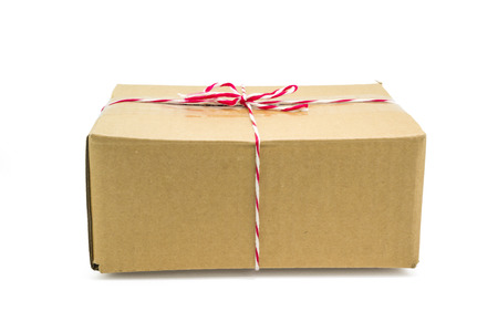 pack string: Parcel cardboard box and tied with string, isolated on white background