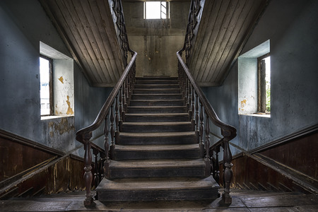 Wooden staircase in an abandoned house. high dynamic range processed