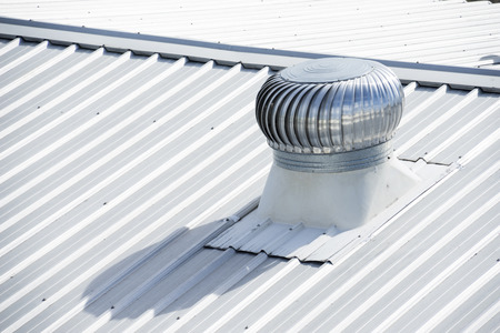 exhaust fan: Stainless steel exhaust fan on factory roof.