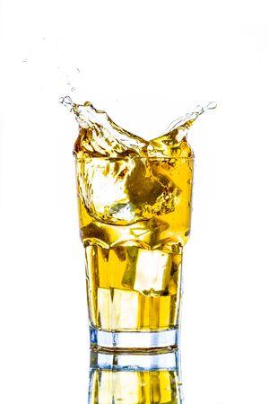 Ice tea with lemon splash, Isolated white background