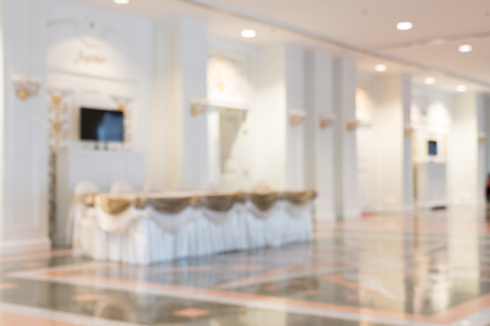 crowded space: Blurred photo of corridor in modern building, background uses Stock Photo