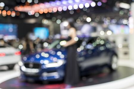 uses: Blurred photo of motor show, background uses
