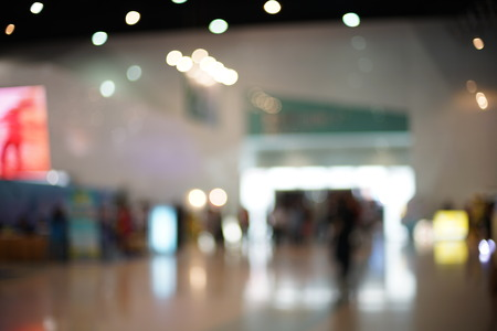crowded space: Blurred photo of corridor in modern building, background uses.
