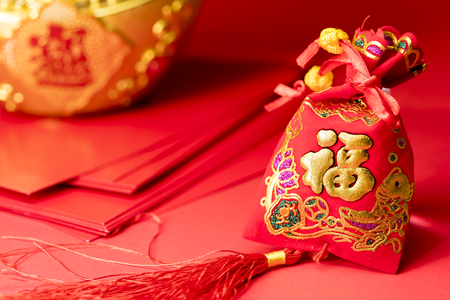 Chinese new year decorations and Auspicious ornaments on red background, Selected Focus. Foreign Text on this image is Chinese word the meaning is Blessing word
