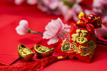 ingots: Chinese new year decorations, Auspicious ornaments on red background, Selected Focus, Chinese text mean Blessing word Stock Photo
