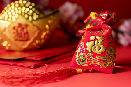 Chinese new year decorations, Auspicious ornaments on red background, Selected Focus, Chinese text mean Blessing word 스톡 콘텐츠