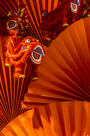 greetings card: Chinese traditional dancing lion on red background.