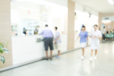 visitors area: Blurred image of unidentified people and patient waiting doctor or medicine in hospital, for background uses. Stock Photo