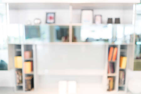 uses: Blurred image of bookshelf for backgrounds uses. Stock Photo