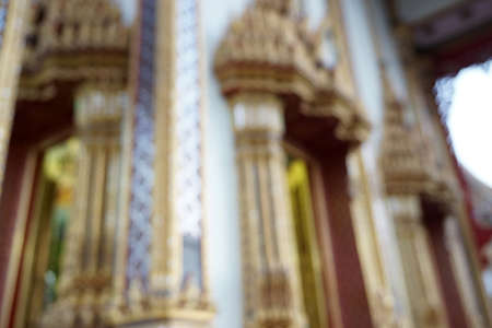 uses: Blurred image of wat in Bangkok, Thailand for background uses.