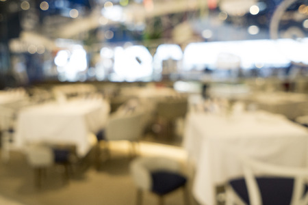 shop for: blurred image of restaurant or coffee shop for background use. Stock Photo