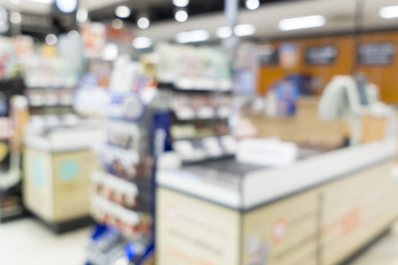Blurred image of suppermarket cashier for background uses.