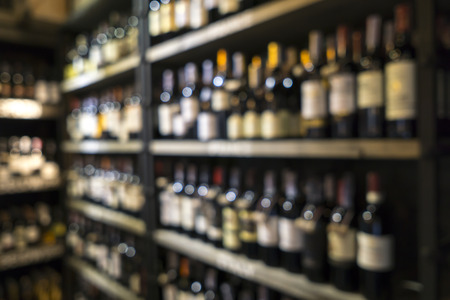 beverage display: Blurred image of liquor shop for background uses. Stock Photo