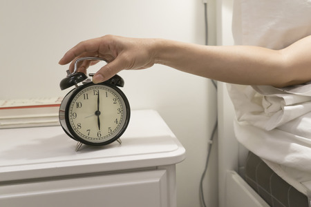 hand reaching: Hand reaching out for alarm clock.