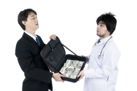 doctor money: Businessman offered a lot of money to the doctor do corrupt. Stock Photo