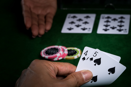 In blackjack the player is betting card in hand against that of the dealer and The banker surrender when an opponent with superior points win in card game. Stock Photo