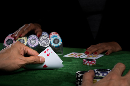 A Hand Holding The Cards Show Face Values Over The Opponent To ...
