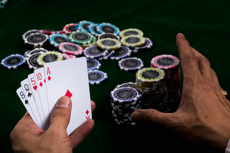 The gambler using a ruse to lure other players with pushing a lot of chips into pile bets, although the score poker cards in hand will be low.